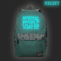 Бирюзовый рюкзак со светящейся надписью Normal People Scare Me (Американская история ужасов) купить в Москве